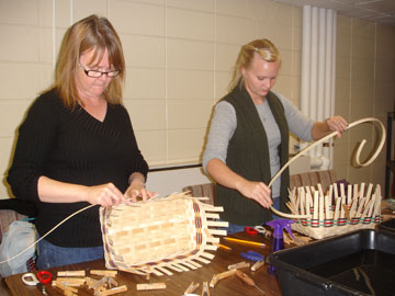 Two Women Weaving Baskets at a Community Education Class at the Heider Center