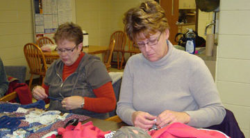 Two Women Sewing at a Community Education Class at the Heider Center